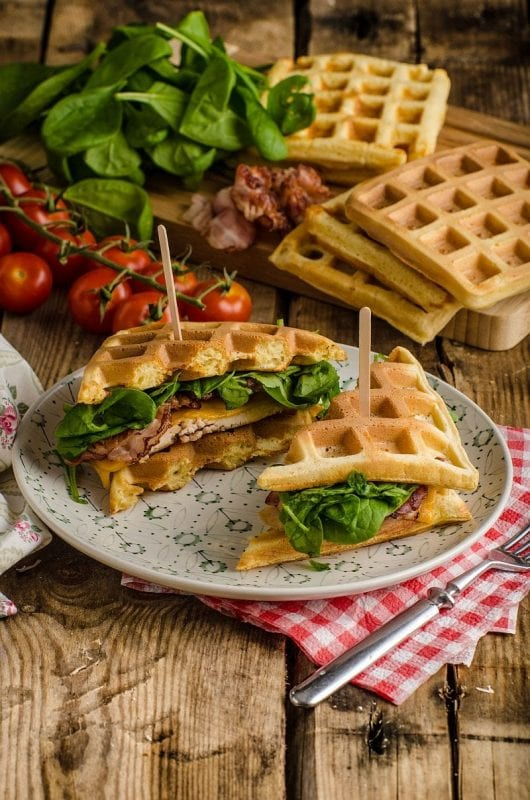 48648332 - waffles sandwich with bacon, chicken and fresh salad